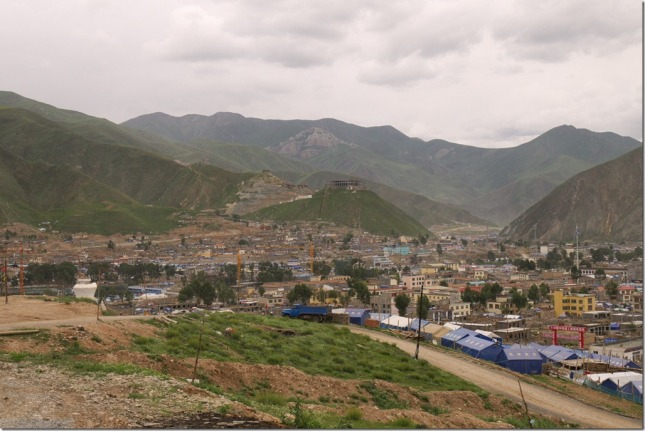 A bird-view of the Kyegu Town. Kyegu Monasery is rebuilding far away on the top of the oppositing hill.